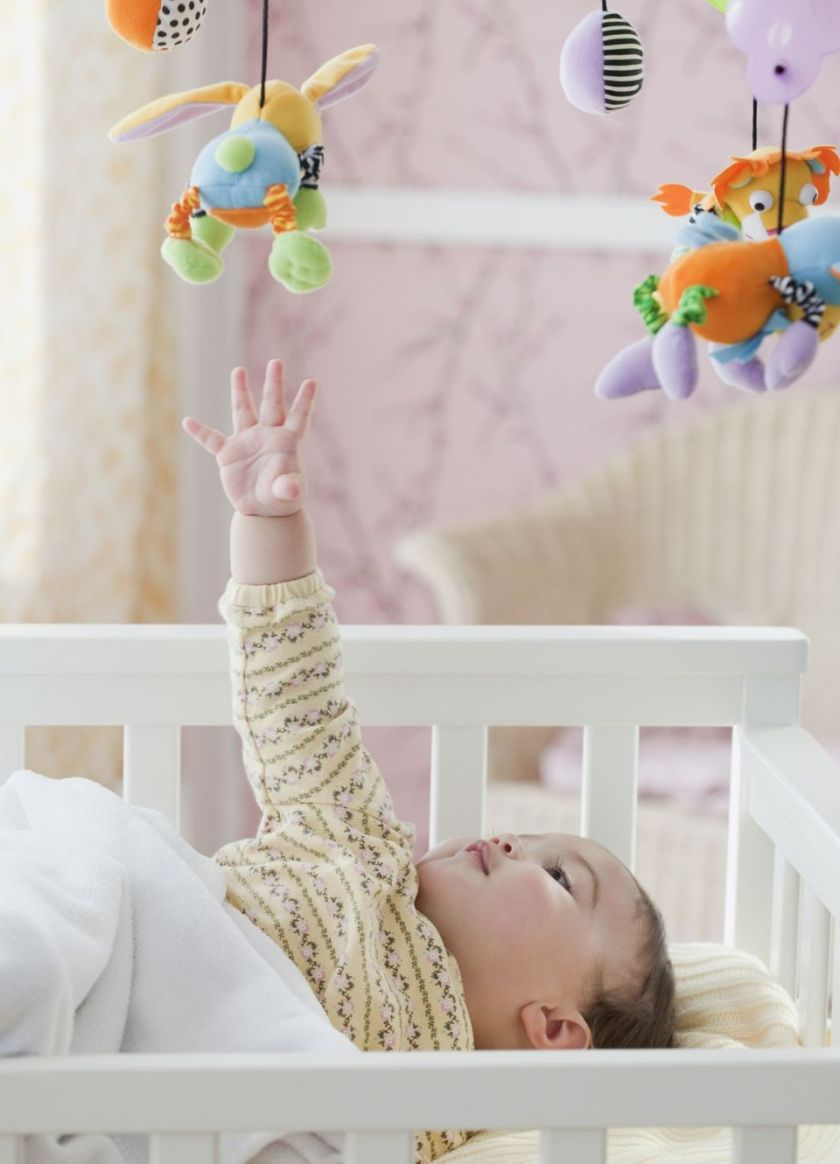 Baby-reaching-for-mobile-56a6b24d5f9b58b7d0e45870